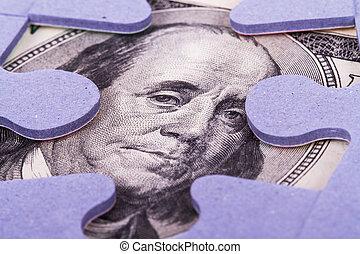 Dollar Banknote between Puzzle Pieces