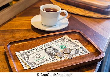 Dollar banknotes and coins, money tips. - Dollar banknotes ...