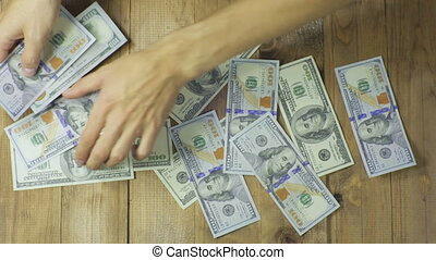 Dollar Banknotes on a Wooden Table - Dollars Banknotes on a...