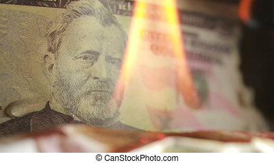dollar bill on fire. fire and money. 50