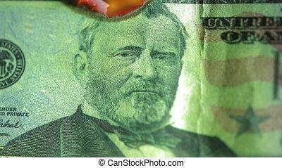 dollar bill on fire. fire and money