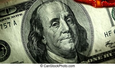 Dollar bill USA money burning in flames, economic crisis or...