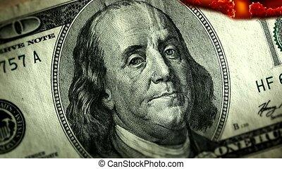 Dollar bill USA money burning in flames, economic crisis or...