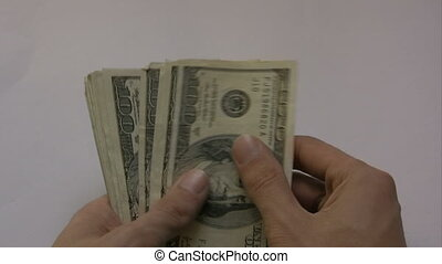 dollar bills in the hands of persons