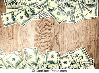 dollar bills on wooden background with copy space for text