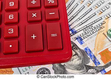 dollar bills with a calculator