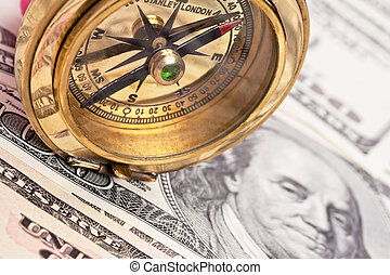 Dollar Currency notes and compass - Many dollar bills and...