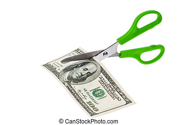 dollar currency notes and scissors. debt and budget. taxes...