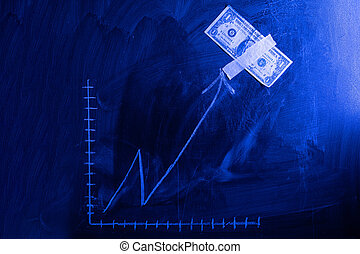 Dollar growth chart drawn on chalkboard. Investment concepts and interests Business growth. Rising graph made out of dollars.