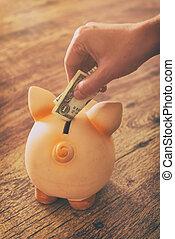dollar, hand, het putten, piggy, een, bank