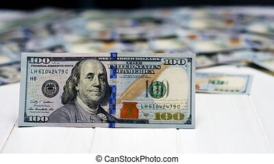 Dollar hundred bill on the background of dollars