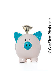 Dollar note sticking out of hand painted blue and white piggy bank on white background