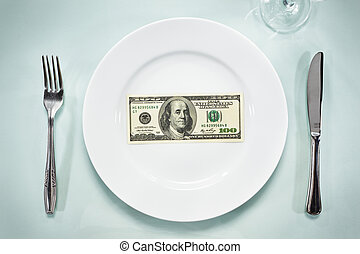 US $ 100 bills on the plate, setting on the glass table