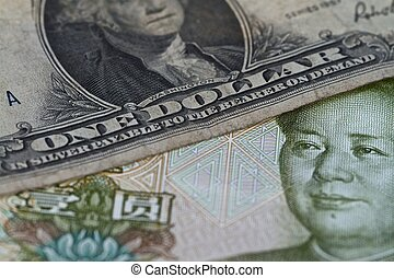 Dollar on yuan - US dollar bank note on top of Chinese yuan ...