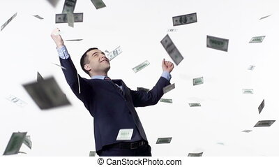 Dollar Rain - Slow motion of dollars falling on man in...