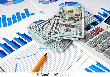 Financial planning concept. - Dollars and calculator on...