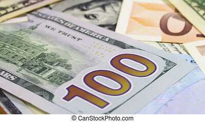 Dollars and Euro Banknotes Rotate