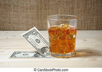Dollars and glass of whiskey with i
