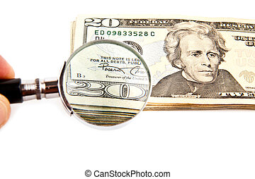 dollars and magnifying glass on a white background