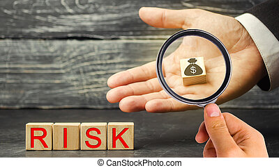 Dollars and the inscription Risk in the hands of a businessman. The concept of financial risk and investing in a business project. Making the right decision. Property insurance. Legal and market risks