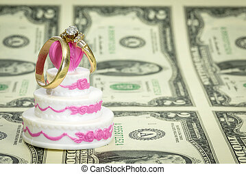 Dollars and wedding cake with rings