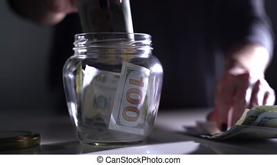Dollars are closed in a secreted jar