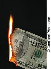 Dollars bill on fire - One hundred dollars bill on fire over...