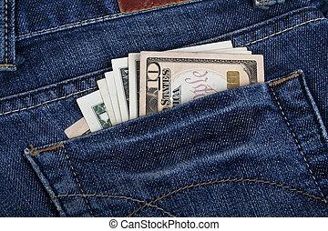 Dollars bills in blue jeans back pocket