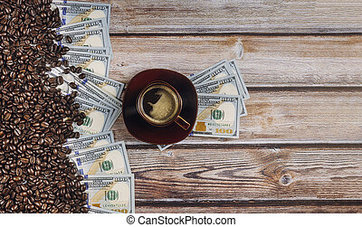 Dollars covered with coffee beans on wooden background and coffee cup