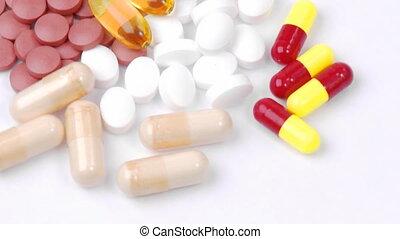 dollars, en, kleurrijke, pillen, draaien