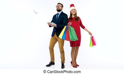 Dollars falling on formally dressed man and woman in the...