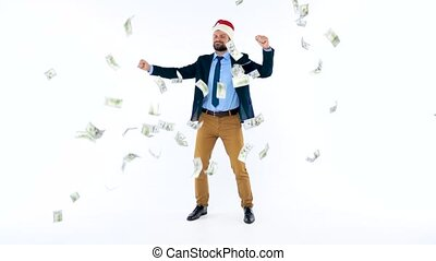 Dollars falling on formally dressed man in the Santa Claus...