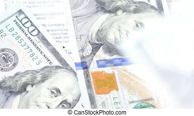 Dollars falling on the tax form. 4K Ultra HD video