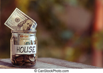 Dollars in a glass jar. Savings for purchase of the house.