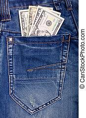 Dollars in blue jeans pocket