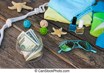 Dollars in glass jar. Concept of collecting money for journey.