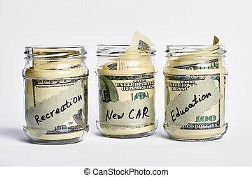 Dollars in money jars.