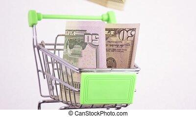 Dollars in the basket - In a metal basket put dollars