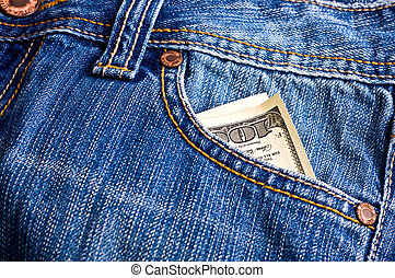 Dollars in the pocket of jeans