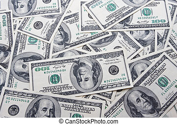 Dollars - Lots of dollar notes arranged in chaotic manner,...