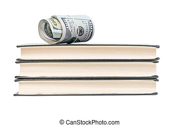 Dollars on a pile of books