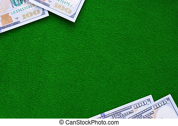 Dollars on casino green felt table