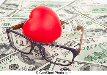 Dollars, red  heart and glasses