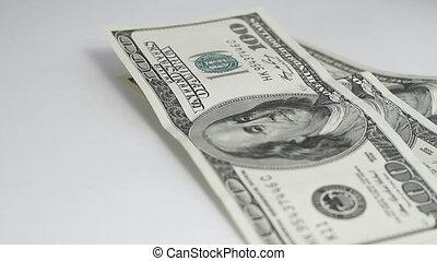 Dollars turning close up