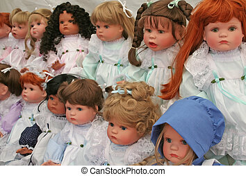 Dolls - An abstract of colourful toy dolls in a row