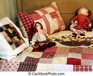 Dolls - Pretty patchwork quilt dolls on a bed