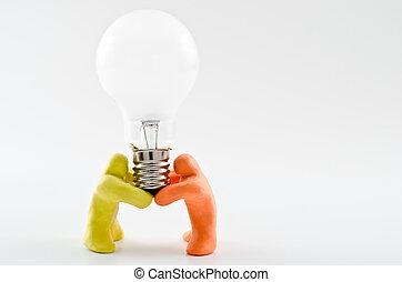 Dolls supporting light bulb