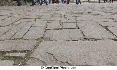 Dolly: Ancient cobblestone pavement in old town - Ancient...