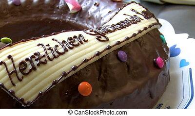 dolly around birthday cake close