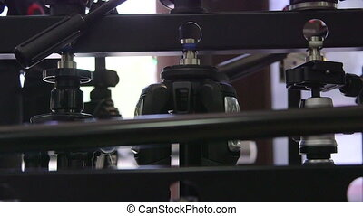 Dolly: Camera tripods for sale at photographic equipment store